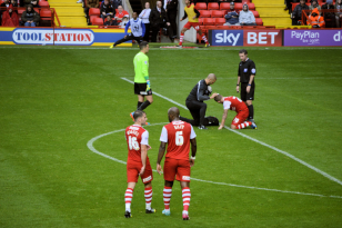 Friendly Pompey vs Charlton 2nd August 2014.  Solly receives treatment.