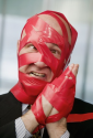 Office Bloke Covered In Red Tape